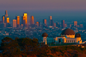 Los Angeles skyline at sunset with Griffith Observatory in the forefront