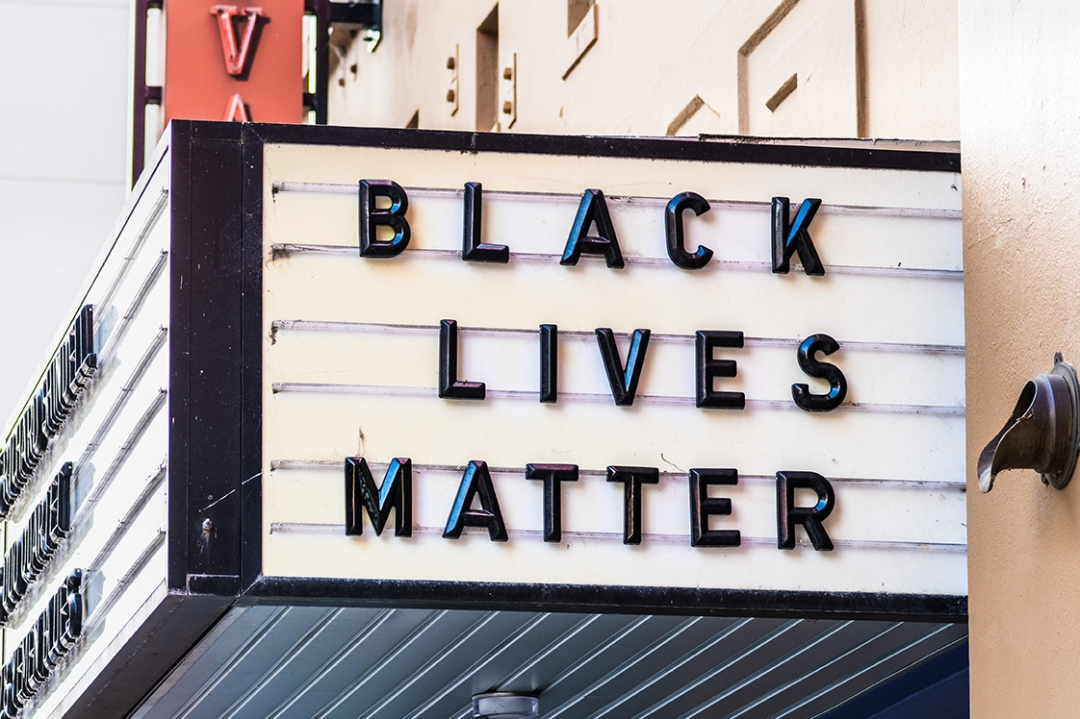black lives matter in black lettering on white marquee